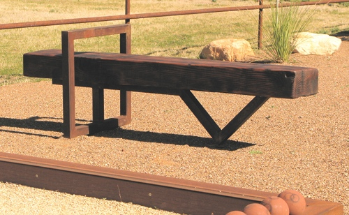 Cantilever bench complements a bocce ball court