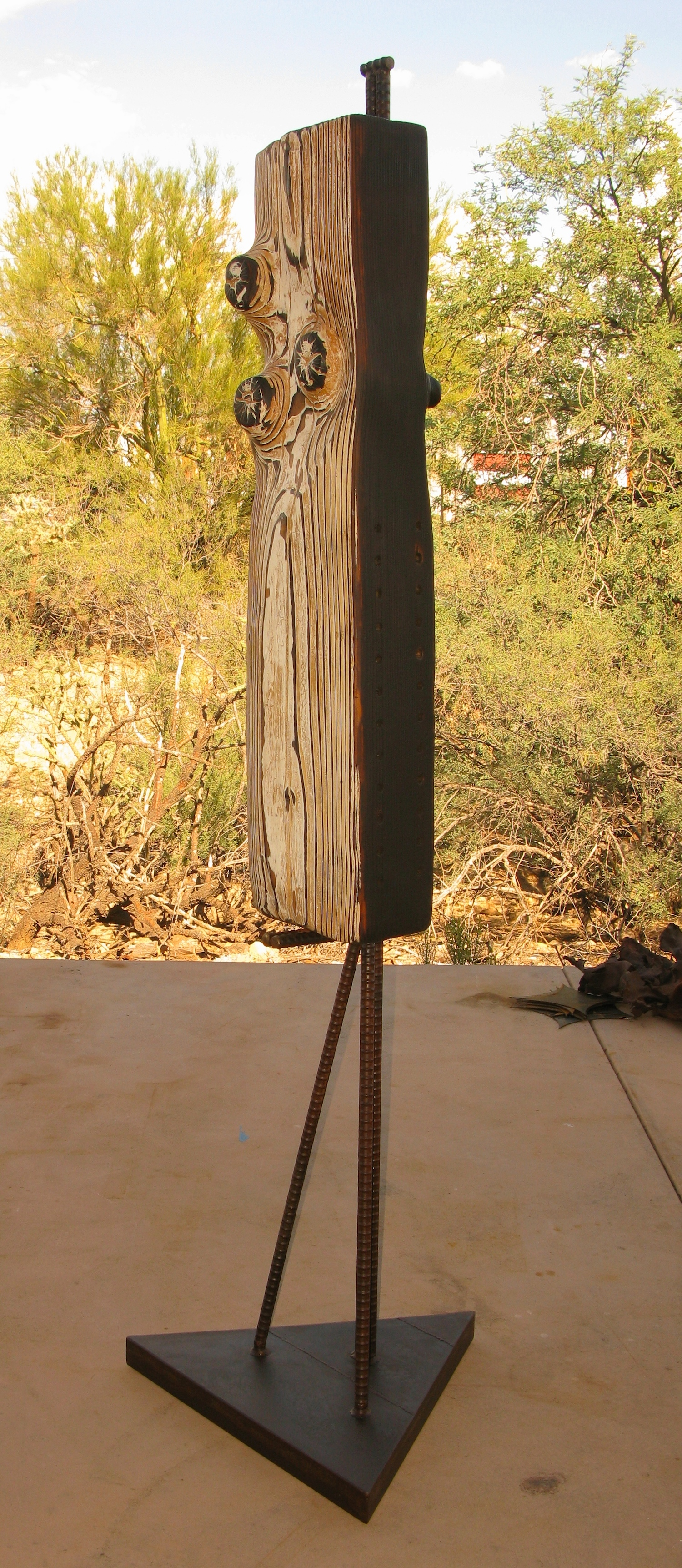 Bee habitat sculpture with triangular base