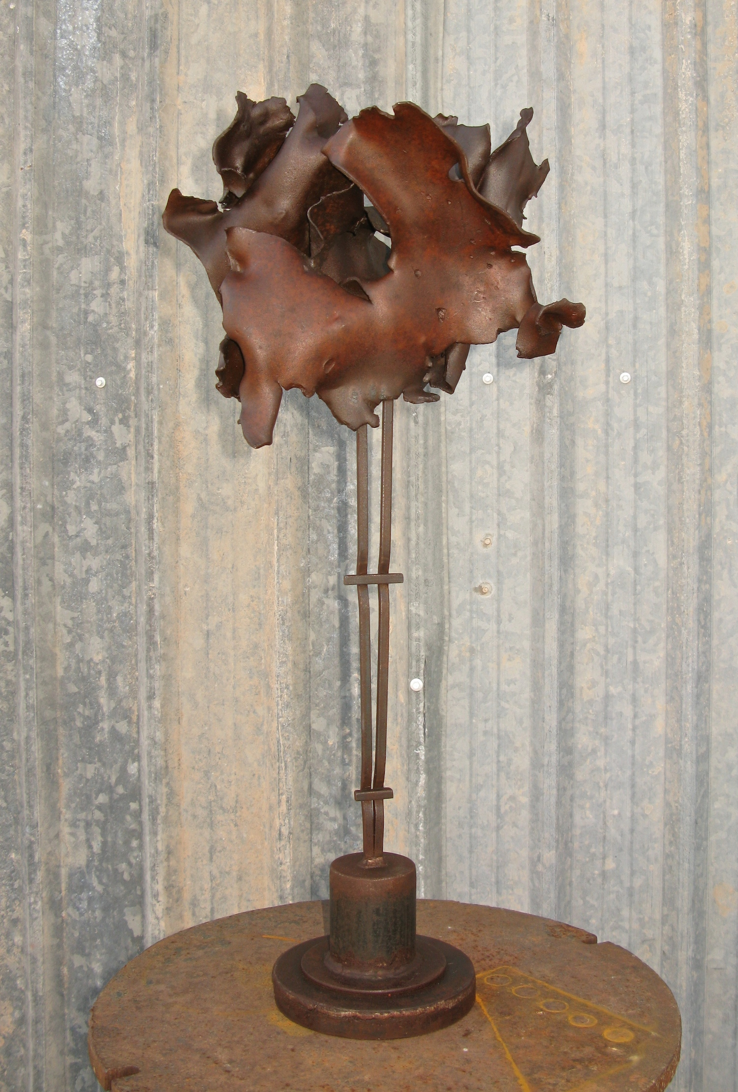 Small sculpture made with ripped and crushed steel